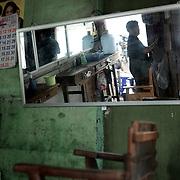 May 15, 2013 - Meiktila, Myanmar: A barber shop in a residential neighbourhood severely destroyed by anti-muslim violence in Meiktila, central Myanmar. (Paulo Nunes dos Santos/Polaris)