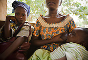 A woman breast feeds her child at the Adja-Ouere community health center in the village of Adja-Ouere, Benin on Friday September 14, 2007.