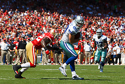 September 18, 2011; San Francisco, CA, USA; Dallas Cowboys tight end John Phillips (89) catches a pass in front of San Francisco 49ers inside linebacker Patrick Willis (52) during the first quarter at Candlestick Park.