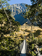 West Matukituki River swing bridge takes you to the Rob Roy Valley track in Mount Aspiring National Park, Southern Alps, South Island, New Zealand. In 1990, UNESCO honored Te Wahipounamu - South West New Zealand as a World Heritage Area.