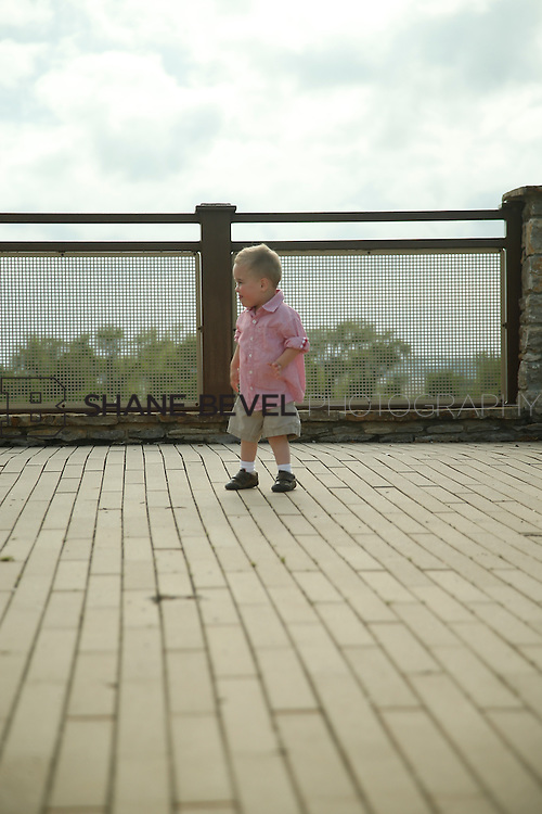 5/28/15 5:50:22 PM -- Miracle Miles and his family pose for portraits and play at the QuikTrip park for the 2015 Saint Francis Health System advertising campaign. <br /> <br /> Photo by Shane Bevel