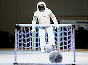 Honda's humanoid robot Asimo kicks a soccer ball during a display at Robo Japan 2008 in Yokohama, Japan.
