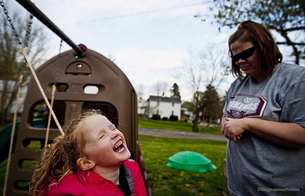 Tomi Sue yells from her swing at her mother, Jana, after she tells her they must go inside before it starts raining, on Tuesday afternoon, April 21, in their McArthur home. Jana usually gives into her daughter's  wishes and laughs when she doesn't obey her.