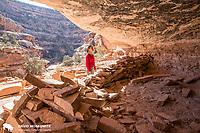 Darcy Ottey inspects the 7 Kiva's ruin on Cedar Mesa, Utah.