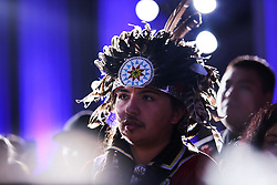 Guests listen to US President Barack Obama speaks at the 2016 White House Tribal Nations Conference at the Andrew W. Mellon Auditorium, September 26, 2016, Washington, DC. The conference provides tribal leaders with opportunity to interact directly with federal government officials and members of the White House Council on Native American Affairs. (Pool/Aude Guerrucci)