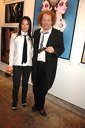 MIKE FIGGIS and pianist ROSEY CHAN at the launch of 'Glenmorangie 5 Senses' an exhibition of photographs by Mike Figgis held at Proud Camden, Stables Market, London NW1 on 13th May 2008.<br />
