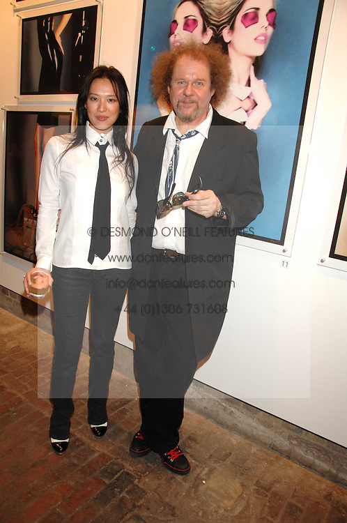 MIKE FIGGIS and pianist ROSEY CHAN at the launch of 'Glenmorangie 5 Senses' an exhibition of photographs by Mike Figgis held at Proud Camden, Stables Market, London NW1 on 13th May 2008.<br /><br />NON EXCLUSIVE - WORLD RIGHTS