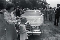 1976, Georgia, USA --- Rosalynn Carter, wife of Democratic presidential candidate Jimmy Carter, combs her daughter Amy's hair at home in Georgia after the 1976 Democratic National Convention. In the background, reporters talk with vice presidential candidate Walter Mondale and his wife, Joan (right). --- Image by © Owen Franken/Corbis