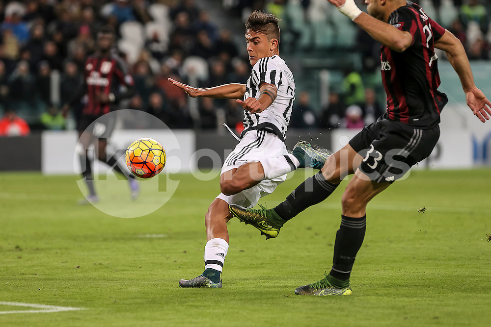 Paulo Dybala of Juventus scores the opening goal during the Serie A TIM match between Juventus and AC Milan at the Juventus Stadium, Turin, Italy on 21 November 2015. Photo by sync studio.