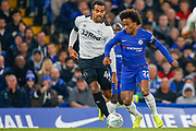 Chelsea midfielder Willian (22) goes past Derby County midfielder Tom Huddlestone (44) during the EFL Cup 4th round match between Chelsea and Derby County at Stamford Bridge, London, England on 31 October 2018.
