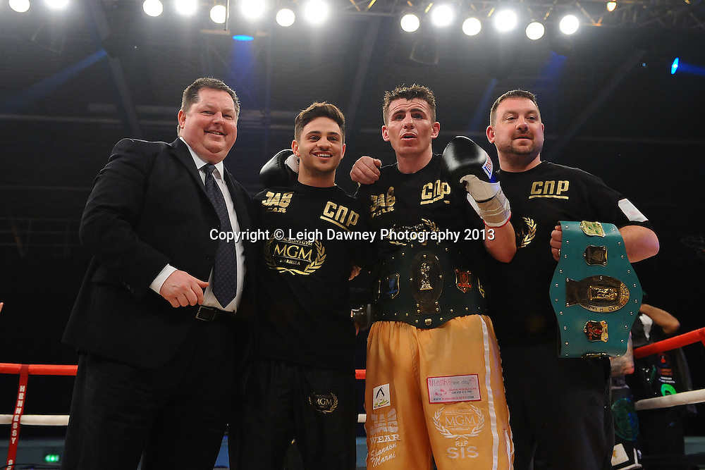 Mick Hennesst (promoter) celebrates with Peter McDonagh and his team after  claiming the Vacant Irish Light Middleweight Title against John Hutchinson on 15th March 2014 at the Rivermead Leisure Centre, Reading, Berkshire. Promoted by Hennessy Sports. © Leigh Dawney Photography 2014.