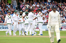 South Africa's Keshav Maharaj celebrates with Vernon Philander (centre right) after taking the wicket of England's Liam Dawson (right) during day two of the Second Investec Test match at Trent Bridge, Nottingham.