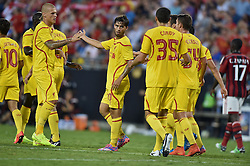 CHARLOTTE, USA - Saturday, August 2, 2014: Liverpool's 'Suso' Jesus Joaquin Fernandez Saenz De La Torre celebrates scoring the second goal against AC Milan during the International Champions Cup Group B match at the Bank of America Stadium on day thirteen of the club's USA Tour. (Pic by David Rawcliffe/Propaganda)