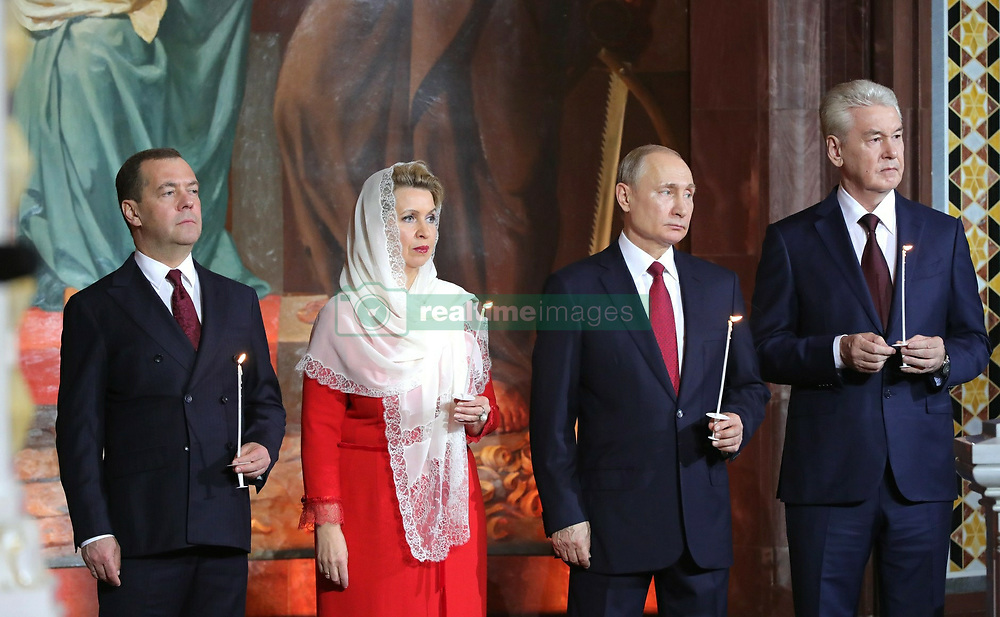 April 29, 2019 - Moscow, Russia - 04/28/2019 Russian President Vladimir Putin, Prime Minister Dmitry Medvedev and Moscow Mayor Sergei Sobyanin attended the Easter mass at the Cathedral of Christ the Savior in Moscow. Photo: Kremlin Pool (Credit Image: © Russian Look via ZUMA Wire)