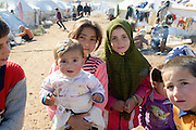 Internally displaced Syrians at a refugee camp near the Turkish border in Atmeh, Syria