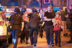 © Licensed to London News Pictures . FILE PICTURE DATED 22/05/2017 as Manchester prepares to mark a year since the Manchester Arena terror attack . Manchester, UK. ANDREW ROUSSOS (with beard) with his son XANDER (carrying dog), whose daughter, Saffie Roussos , was the youngest of those killed in the attack and who would have turned nine today (4th July 2017) . Mr Roussos has spoken publicly about the impact of the Manchester Arena terrorist attack which killed his daughter, in an interview for the BBC's Victoria Derbyshire . Photo credit : Joel Goodman/LNP