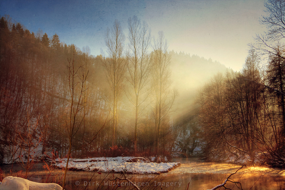 Rising fog on a cold winter morning at river Wupper/ Germany<br />