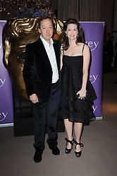 Geordie Greig with his wife Katherine at the Orange BAFTA's Nominees party held at Asprey, 165 New Bond Street, London on 20th February 2010.