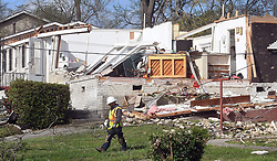 April 16, 2018 - Greensboro, NC, USA - A utility company employee walks past a demolished house in Greensboro, N.C. on Monday, April 16, 2018. A tornado ripped through this eastern Greensboro neighborhood, destroying several houses. One man was killed when a tree fell on his vehicle during the storm. (Credit Image: © Chuck Liddy/TNS via ZUMA Wire)