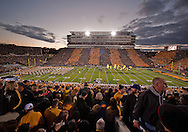 October 2 2010: Fans cheer as the Iowa Hawkeyes take the field before the start of the first half of the NCAA football game between the Penn State Nittany Lions and the Iowa Hawkeyes at Kinnick Stadium in Iowa City, Iowa on Saturday October 2, 2010. Iowa defeated Penn State 24-3.