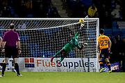 Oldham Athletic goalkeper Johny Placide (19) tips the ball onto the bar during the EFL Sky Bet League 1 match between Gillingham and Oldham Athletic at the MEMS Priestfield Stadium, Gillingham, England on 25 November 2017. Photo by Martin Cole.