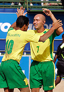 07 December 2006, Brazil's Sidney Souto (right) and Benjamin da Silva celebrate after scoring against England during the first game of the Vodacom Pro Beach Soccer Tour starts at Durban's Bay of Plenty on Thursday. Brazil won the game 10 - 3. Picture: Shayne Robinson, PhotoWire Africa