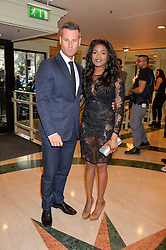 TIM VINCENT and guest at the 6th annual Asian Awards held at The Grosvenor House Hotel, Park Lane, London on 8th April 2016.