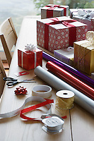 Christmas gifts wrapping paper and accessories on table
