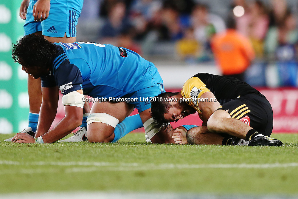 Nehe Milner-Skudder of the Hurricanes picks up an injury after a tackle from Steven Luatua of the Blues. Super Rugby match, Blues v Hurricanes at Eden Park, Auckland, New Zealand. 11 March 2016. Photo: Anthony Au-Yeung / www.photosport.nz