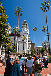 Tourists walk up to Casa Grande, Hearst Castle, California, United States of America