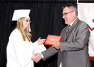 Sarah Mae Bowers gets a handshake from principal David White during the 55th Annual Belmont High School commencement at the new BHS gymnasium, Saturday, May 19, 2012.  1,700 tickets were sold to the 2012 'Imagine' commencement.