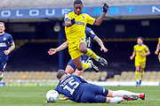 AFC Wimbledon attacker Michael Folivi (41) jumping over a tackle from Southend United defender Rob Kiernan (15) during the EFL Sky Bet League 1 match between Southend United and AFC Wimbledon at Roots Hall, Southend, England on 16 March 2019.