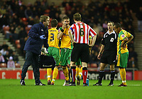 Photo: Andrew Unwin.<br />Sunderland v Norwich City. Coca Cola Championship. 02/12/2006.<br />Sunderland's Gary Caldwell (#6) checks on Norwich's Carl Robinson (C) after a collision left the latter on the floor.