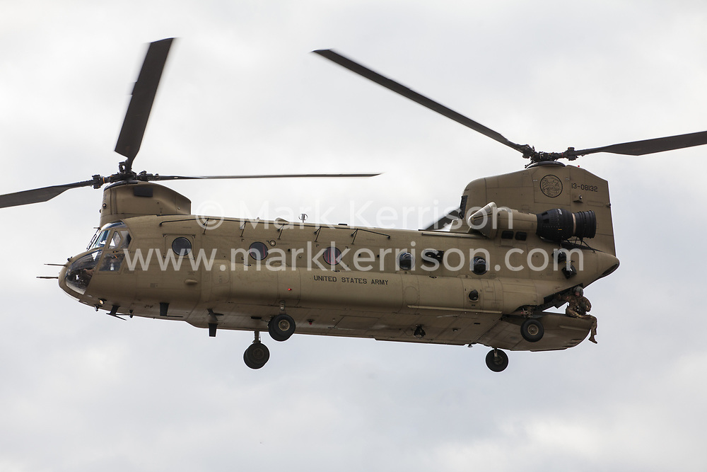 London, UK. 7 September, 2019. A military helicopter lands outside ExCel London during the sixth day of Stop The Arms Fair protests against DSEI, the world's largest arms fair. The sixth day of protests was billed as a Festival of Resistance and included performances, entertainment for children and workshops as well as activities intended to disrupt deliveries to ExCel London for the arms fair.