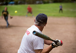 John tracks the pitch as the Montclair softball league celebrates its 50th season, Saturday, April 22, 2017, at Montclair Park in Oakland, Calif. The pickup softball game, played every Saturday by a group of enthusiasts ranging in age from 20 to 75, started in 1968 in Berkeley and moved to Montclair about 25 years ago. (Photo by D. Ross Cameron)