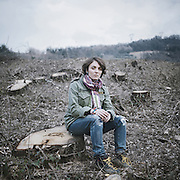 "Maria Paola Di Sebastiano, a founding member of the ""No Power Line"" committee, sits among oak trees that were cut to make way for one of the pillars of the Villanova-Gissi mega power line. ""I carry on with my battle because I cannot accept to lose the woods and the hills which have always been the backdrop of my life [...] I do not accept that all of this was done covertly and that the citizens of Filetto got to know the truth when the works had already started.""<br />