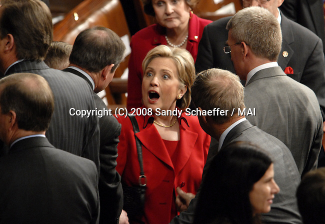US Senator Hillary Clinton (D-NY) speaks with fellow members of Congress and also listens to President George Bush as he presents his 7th and final State of the Union Address to a joint session of the US Congress on Capitol Hill on January 28, 2008