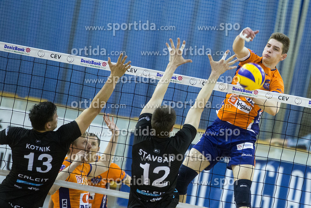 Domen Kotnik of Calcit and Jernej Stavbar of Calcit vs Mario Koncilja of ACH during volleyball match between ACH Volley and Calcit Volleyball in Round #3 of Finals of 1. DOL Slovenian Championship 2014/15, on April 19, 2015 in Hala Tivoli, Ljubljana, Slovenia.  Photo by Vid Ponikvar / Sportida