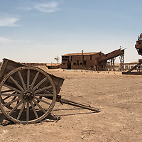 "According to the description of the ""UNESCO World Heritage website"" - Humberstone and Santa Laura works contain over 200 former saltpeter works where workers from Chile, Peru and Bolivia lived in company towns and forged a distinctive communal pampinos culture. That culture is manifest in their rich language, creativity, and solidarity, and, above all, in their pioneering struggle for social justice, which had a profound impact on social history. Situated in the remote desert Pampa, one of the driest deserts on earth, thousands of pampinos lived and worked in this hostile environment, for over 60 years, from 1880, to process the largest deposit of saltpeter in the world, producing the fertilizer sodium nitrate that was to transform agricultural lands in North and South America, and in Europe, and produce great wealth for Chile. Because of the vulnerability of the structures and because of the impact of a recent earthquake, the site was also placed on the List of World Heritage in Danger, to help mobilize resources for its conservation."
