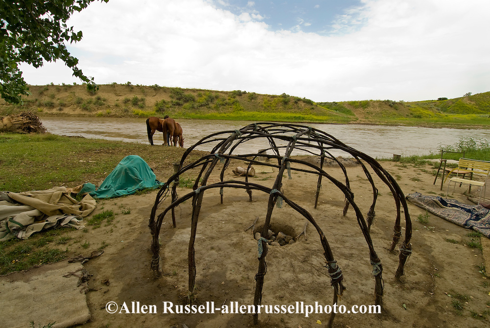 Sweat Lodge frame, Little Bighorn River, Crow Indian Reservation, Medicine Tail Coulee where Battle of the Little Bighorn occurred, Montana, Crow girls water horses.