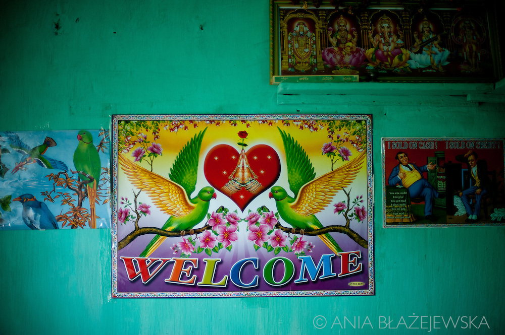 India, Kerala. Decorations inside tea picker's house.