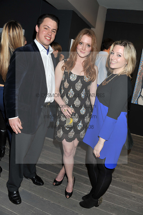 Left to right, FREDDIE de SIBERT, OLIVIA HALLINAN and ARIANE BUTEUX at Diego Bivero-Volpe's 30th birthday party in aid of the charity Kids Company held at the Rook & Raven Gallery, 7 Rathbone Place, London W1 on 12th April 2013.