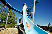 Trey Recanzone, 13, from Burns, Ore., speeds through the water Thursday on one of the Velocity Peak slides at Silverwood Theme Park's Boulder Beach. The amusement park is one pace to break its season attendance record of 628,000.