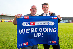 Free to use courtesy of Sky Bet - Wigan Athletic manager Paul Cook and Chairman David Shapre celebrate winning promotion to the Sky Bet Championship - Mandatory by-line: Robbie Stephenson/JMP - 21/04/2018 - FOOTBALL - Highbury Stadium - Fleetwood, England - Fleetwood Town v Wigan Athletic - Sky Bet League One