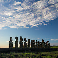 Moai are carved stone human figures created by the Rapa Nui people.  The statues are located in the Pacific Ocean on Easter Island, Chile.
