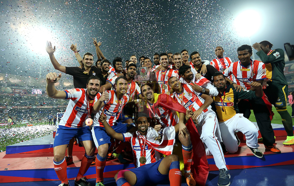 Atletico de Kolkata celebrate after winning the final of the Hero Indian Super League between Kerala Blasters FC and Atletico de Kolkata held at the D.Y. Patil Stadium, Navi Mumbai, India on the 2oth December 2014.<br /> <br /> Photo by:  Sandeep Shetty / ISL/ SPORTZPICS