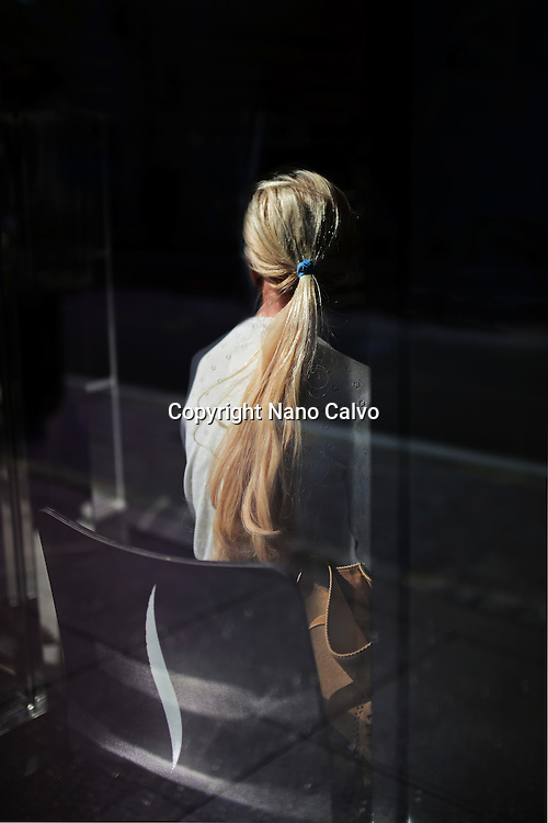 Young blonde woman waiting inside Sephora store at The Grove, Los Angeles.