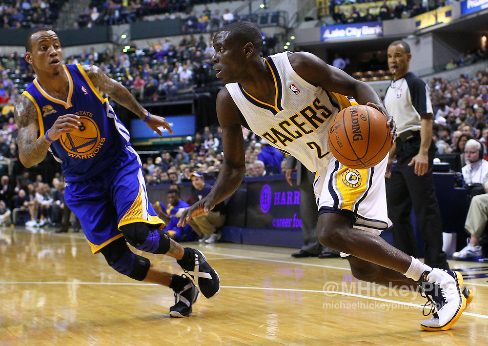 Feb. 28, 2012; Indianapolis, IN, USA; Indiana Pacers point guard Darren Collison (2) dribbles the ball against Golden State Warriors shooting guard Monta Ellis (8) at Bankers Life Fieldhouse. Indiana defeated Golden State 102-78. Mandatory credit: Michael Hickey-US PRESSWIRE