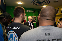 North Woolwich, London, October 28th 2014.  The Mayor of London, Boris Johnson, visits a training session at Fight for Peace Academy in Newham.<br /> <br /> Fight for Peace uses boxing and martial arts combined with education and personal development to realise the potential of young people in the borough at risk of crime and violence. First established in Rio in 2000 by Luke Dowdney MBE, it was replicated in Newham in 2007. It is now expanding globally and began rolling out across the UK.<br /> Pictured: Mayor Boris Johnson speaks with members of Fight for Peace before stepping into the ring.