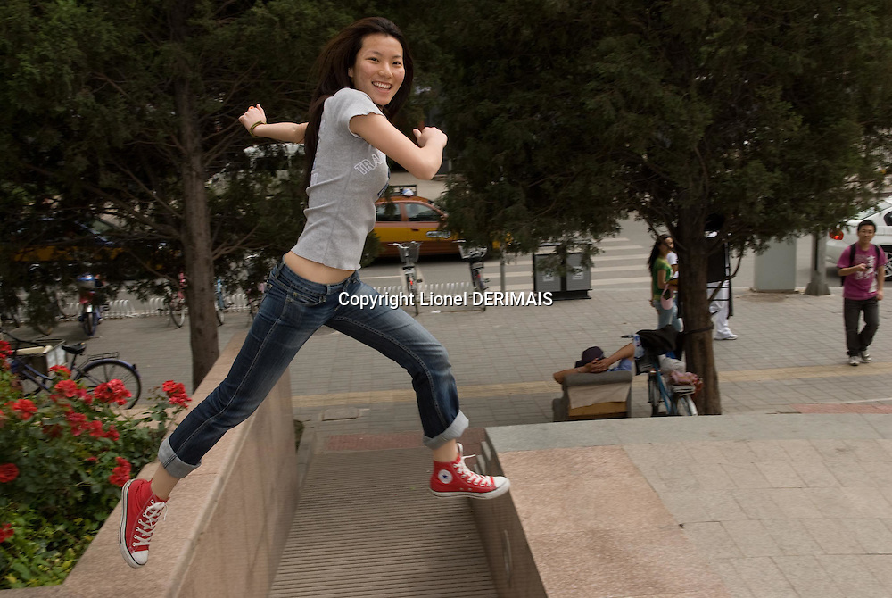 Li Xin, a 20-year-old Chinese girl poses outside the French Cultural Center in Beijing.